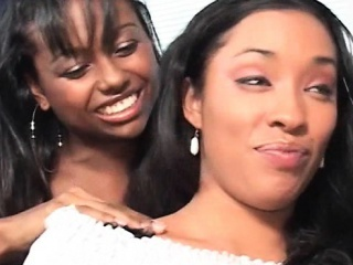 Sensual ebonies kissing and sucking huge boobs